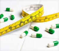 measuring tape and pills